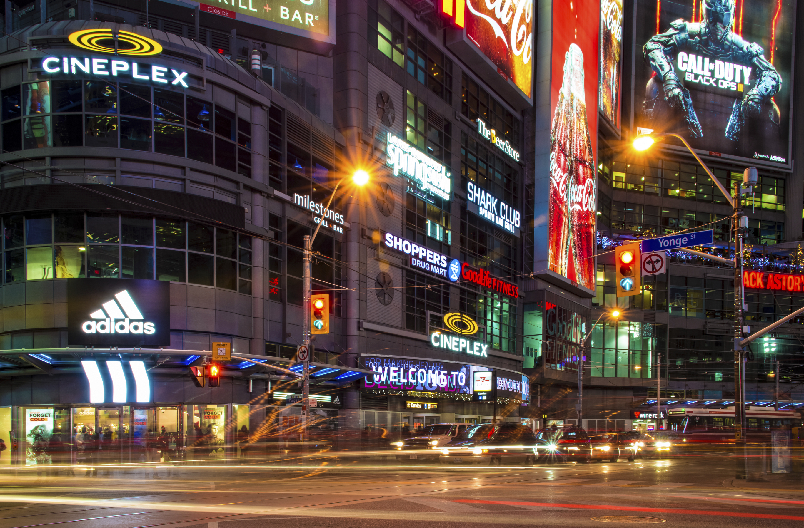 Dundas Square at night time, long exposure. The Toronto landmark is one of the busiest intersection in the city. Yonge-Dundas Square was first conceived in 1997 as part of revitalizing the intersection, and was designed by Brown and Storey Architects.
